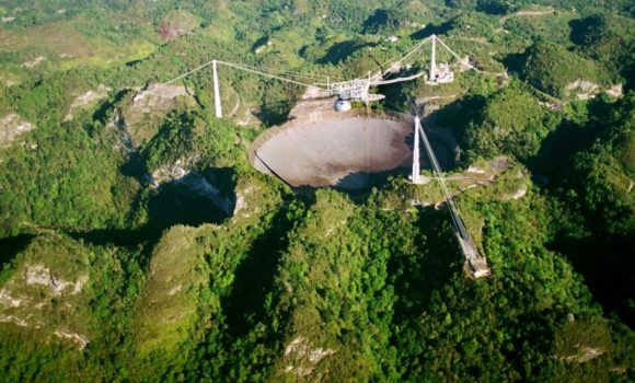 Arecibo Observatory seen from the air, Puerto Rico. ( Photo/ Tomas van Houtryve)