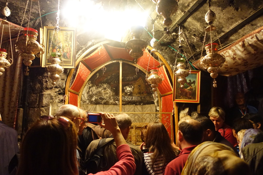 Crowd waiting turns to see the silver star on the floor at the Grotto of Nativity