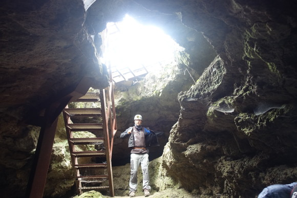 Down the opening to the lava cave (Cueva del Viento)