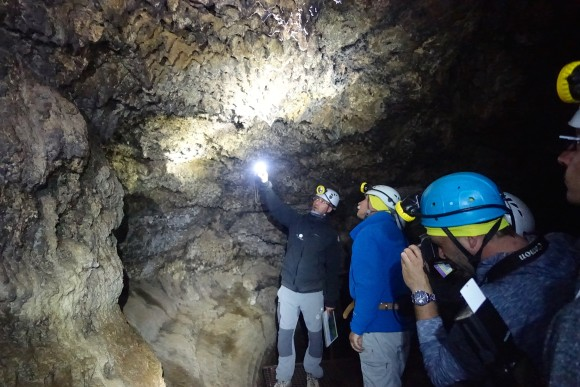 Our guide from Volcano Life Experience explaining the different rock formation in the lava cave