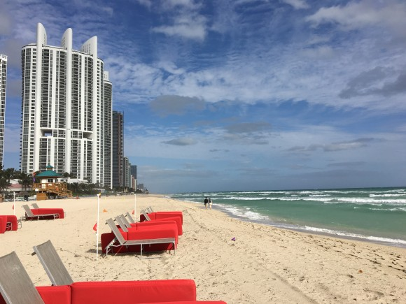 White sand beaches and comfy lounge chairs at Acqualina Resort