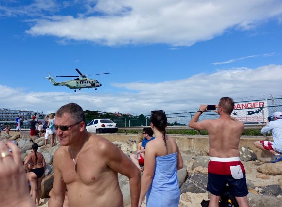 Maho Beach Warning Signs and Helicopter Landing outside of Princess Juliana airport St. Martin