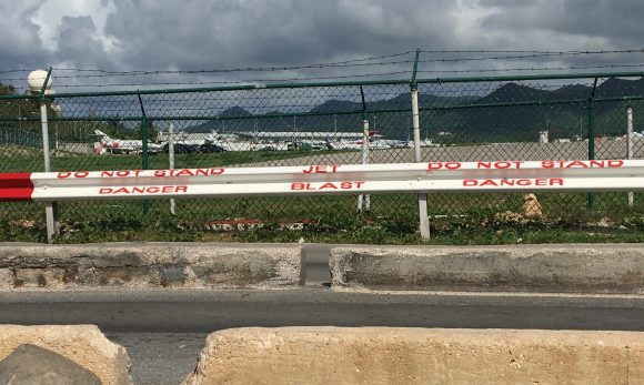 Maho Beach Warning Signs outside of Princess Juliana airport St. Martin