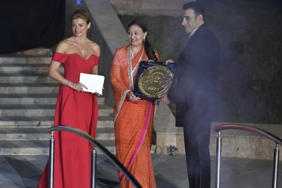 Khalil El-Mouelhy , Chairman President/Founder of the Seven Stars luxury Hospitality and Lifestyle Awards presenting the award to Princess Bhargavi Kumari Mewar for the Shiv Niwas Palace