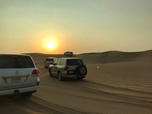 Our 4x4 vehicles driving on the dunes with Arabian Nights Tours