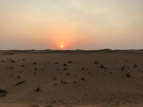 The sunset in the desert of Dubai