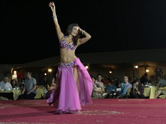 Belly dancing entertainment after dinner in the desert with Arabian Nights Tours