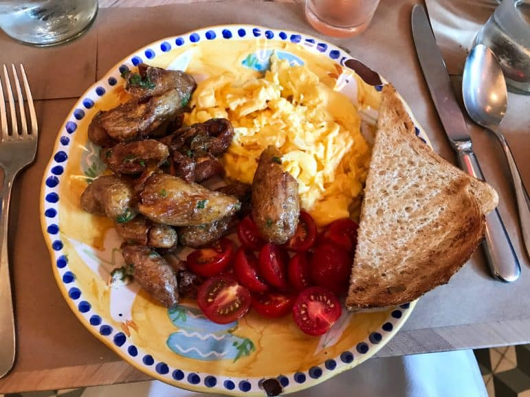 Egg Omelette with a side of potatoes at Leuca Restaurant