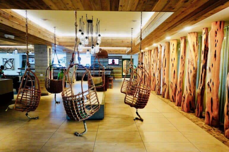 Amara Cay Resort Islamorada - Hanging Chairs in Lobby Area